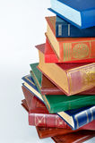 Pile of books. On white background royalty free stock photo