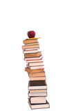 Pile of books. A tall pile of books with an apple and pencil on top Royalty Free Stock Photo