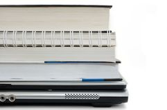 Pile of books. On a laptop Stock Photography
