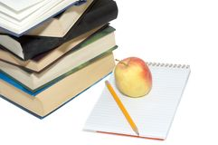 Pile of books. Notepad and apple Royalty Free Stock Image