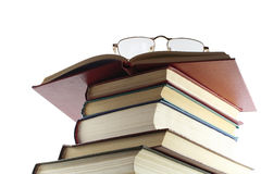 Pile of books, from above glasses it is isolated o Royalty Free Stock Image