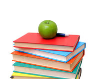 A pile of books and apple. Isolated on white background royalty free stock photos