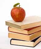 Pile of books and apple. Rred apple on a pile of books and Stock Image