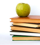 Pile of books and apple. Isolated on white background Royalty Free Stock Photo