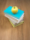 Pile of books with apple Stock Image