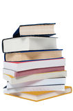 Pile of books. Arranged like tower over white royalty free stock photos