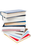 Pile of books arranged like a tower royalty free stock photos