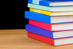 Pile of books on black Stock Photography