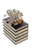 Pile of books with a bow Royalty Free Stock Photo