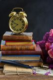Pile of books with clock Royalty Free Stock Photos