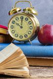 Pile of books with clock Royalty Free Stock Image