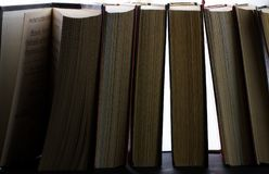 A pile of books in close-up. In the backlight Royalty Free Stock Image
