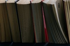 A pile of books in close-up. In the backlight Stock Photography