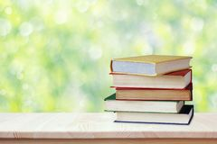 Pile of books in color covers. Workplace of the student. Back to school. Education, study, science. Pile of books in color covers on the table. Workplace of the royalty free stock photo