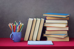 Pile of books, colored pencils. Education, back to school. Royalty Free Stock Images