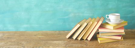 A pile of books and a cup of coffee,large panorama format,. Good copy space royalty free stock image
