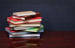 Pile of books on the desk Stock Images