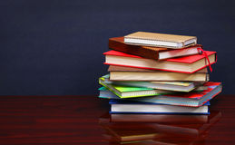 Pile of books on the desk Royalty Free Stock Images