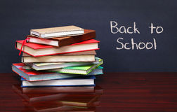 Pile of books on the desk. The words 'Back to School' written Royalty Free Stock Image