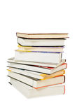 Pile of books. With different colors of covers and white background Stock Photos