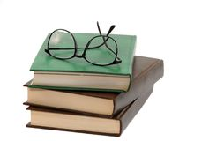 Pile of books and eyeglasses Royalty Free Stock Images