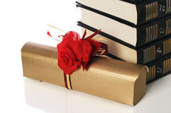 Pile of books and gift Royalty Free Stock Photos
