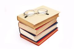 Pile of books with glasses Stock Photo
