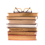 Pile of books and glasses isolated on white background. Collection. Stock Photography