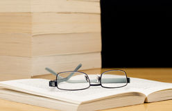 Pile of books with glasses Royalty Free Stock Image
