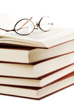 Pile of books with glasses over it Royalty Free Stock Photography