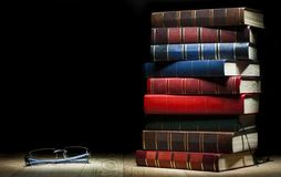 Pile of books and glasses Stock Photography