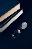 Pile of books and glasses symbolizing the concept Royalty Free Stock Images
