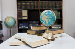 Pile of books and globe Stock Photography