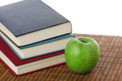 Pile of books and green apple Royalty Free Stock Photo