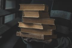 Pile of books in hands stock photo