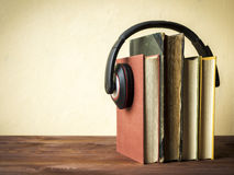 Pile of books with headphones Stock Images