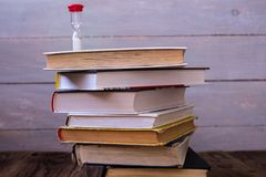 Pile of books and hourglass royalty free stock photo