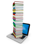 Pile of books on laptop. Tall pile of colourful books on the top of a laptop Royalty Free Stock Photos