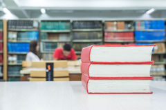 A pile of books with library on the back Royalty Free Stock Images