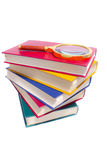 Pile of books and magnifier Royalty Free Stock Photo