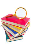 Pile of books and magnifier Stock Image
