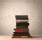 A pile of books with math formulas written in doodle style. On background Stock Image