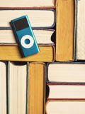 Pile of books with mp3 player Royalty Free Stock Photos