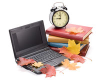 Pile of books, notebook and alarm clock Royalty Free Stock Photography