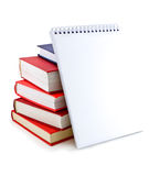 Pile of books and notebook with white sheets. Royalty Free Stock Image