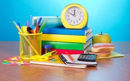 Pile of books, office supply, apple and sandwich Stock Images