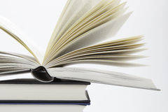 Pile of books with one book open Royalty Free Stock Images