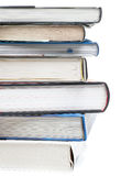 Pile of books with one book open. On white background Royalty Free Stock Photos