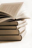 Pile of books with one book open Royalty Free Stock Image