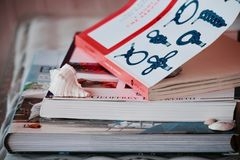 Pile of books with one on knots royalty free stock photos